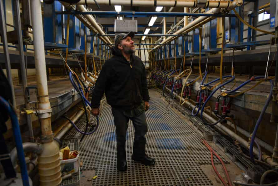 Fifth generation farmer Bob Krocak, stands inside the milking parlor as it was left when his family shut down the dairy business in 2018, Montgomery, Minnesota, March 2019