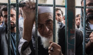 Abdul Ajan, 70, sick and frail, has been waiting for three days to be seen for his visa appointment.
