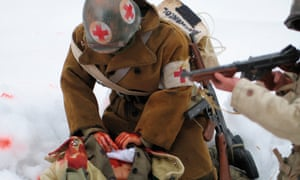 A medic struggles to save a wounded comrade.