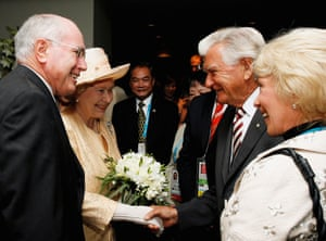 John Howard smiles as the Queen greets his predecessor, Bob Hawke, and his wife, Blanche d'Alpuget, at the opening ceremony for the 2006 Commonwealth Games in Melbourne.