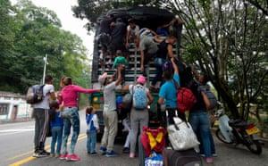 Norte de Santander, Colombia Venezuelan migrants climb on a truck on the road from Cucuta to Pamplona,