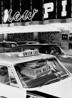 Taxi driver with newspaper announcing the assassination of JFK, Las Vegas 1963