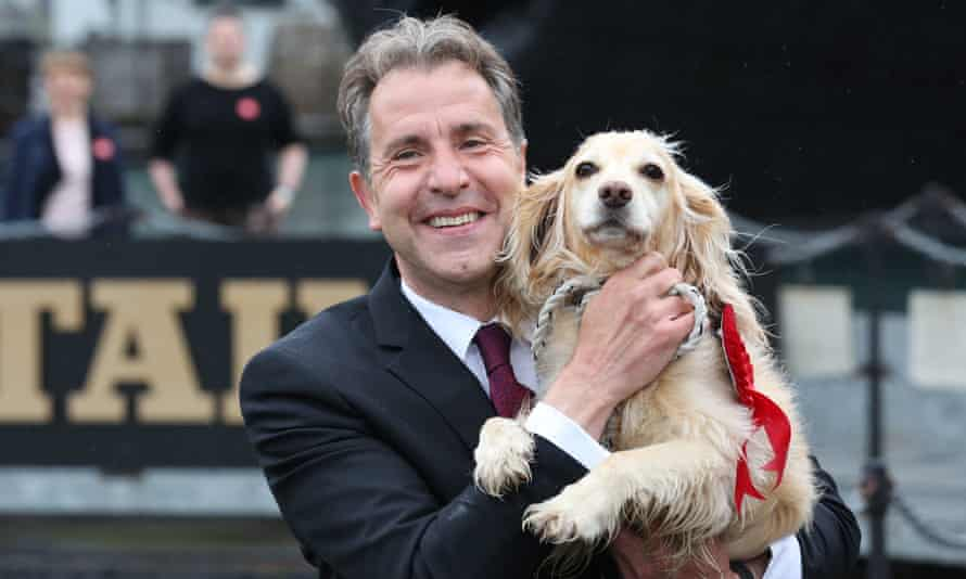 Dan Norris celebrates with his dog, Angel, after being elected West of England mayor