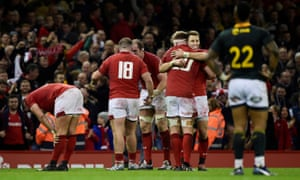 Wales' Liam Williams and Aaron Wainwright celebrate their victory.