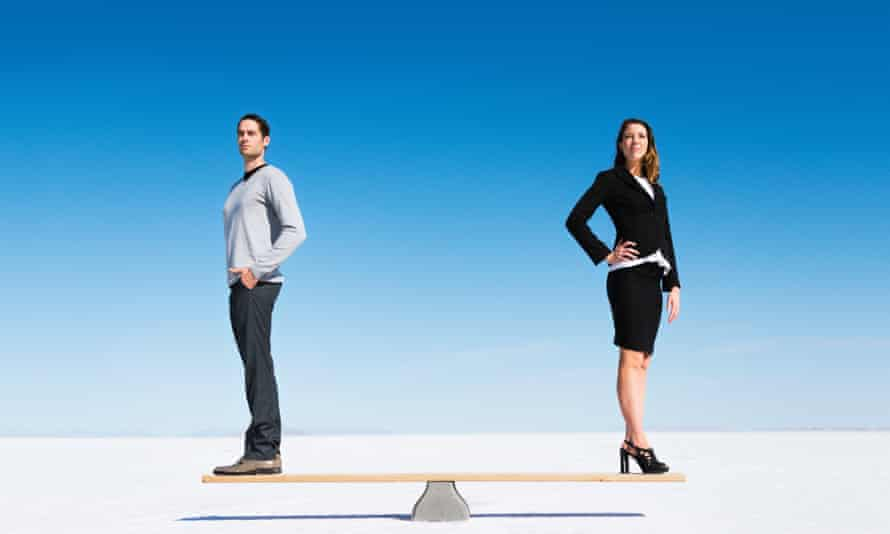 A businesswoman and businessman on a seesaw