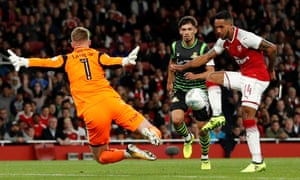 Theo Walcott scores Arsenal's winner against Doncaster Rovers at the Emirates Stadium