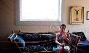 Women at home in Valletta, Malta, surrounding by threads of wool as part of an art project called Altofest.