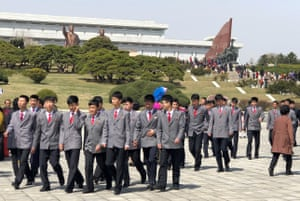 A group of uniformed schoolchildren chat during the celebrations