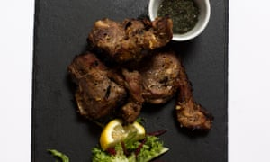 Achari lamb chops on a slate