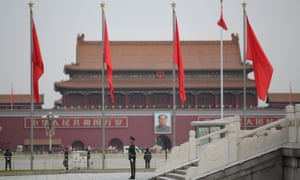 A paramilitary police officer stands guard at Tiananmen Square in Beijing.