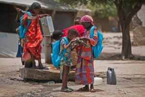 Children ho were forced to flee their homes because of the Boko Haram insurgency drink water in a school yard in Bol, in Chad's Lake region