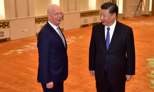 World Economic Forum head Klaus Schwab (left) is welcomed by Chinese President Xi Jinping (right) at the Great Hall of the People in Beijing.