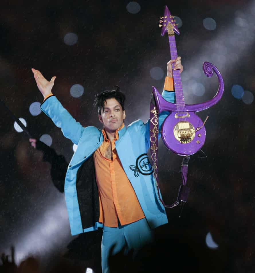 Prince performing during half-time at Super Bowl. The guitar he used during the show will also make an appearance at the O2 exhibition.