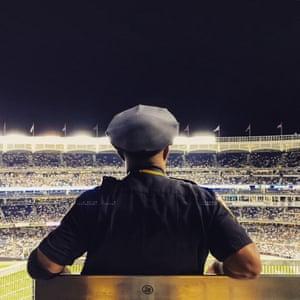 Lone cop at Yankee stadium, New York