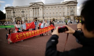 Chinese tourists at Buckingham Palace in London
