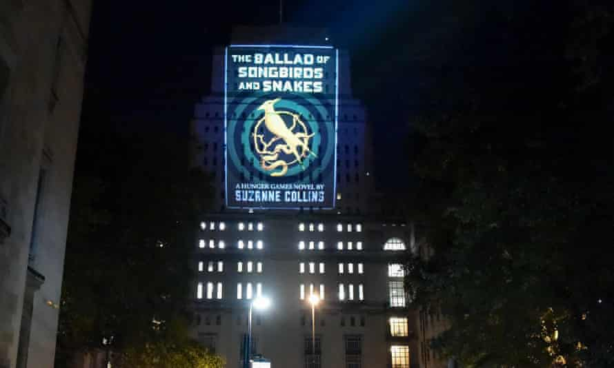 Raising the roof … cover art for The Ballad of Songbirds and Snakes projected on to Senate House in central London.