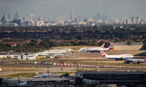 A general view of aircraft at Heathrow airport in front of the London skyline.