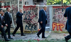 Donald Trump walks back to the White House escorted by the Secret Service after appearing outside St John's Episcopal church on Monday.