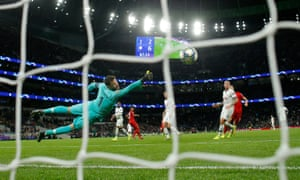 Tottenham Hotspur goalkeeper Hugo Lloris dives in, but fails to stop Serge Gnabry from firing Bayern Munich's seventh goal in a 7-0 win. 2 victory over Spurs.