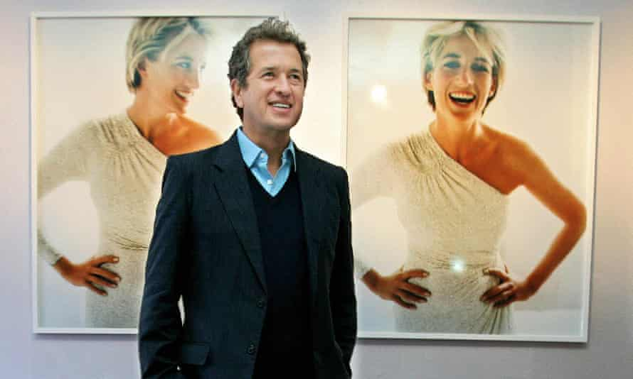 At a Kensington Palace exhibition in 2005, Mario Testino poses with photographs he captured of Princess Diana.