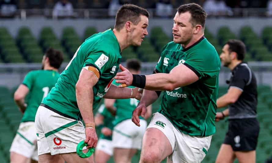Ireland's Johnny Sexton (left) is congratulated by Cian Healy after one of his many successful kicks in a convincing victory against England in Dublin.