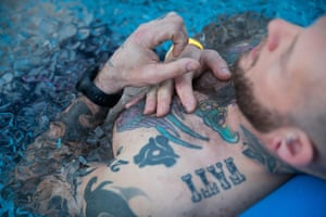 A participant in an ice bath at the Wim Hof Method event.