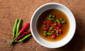 Thai red and green chili in bowl of fish sauce.A high quality version of Phrik Nam Pla – chilli in fish sauce – is the mark of a great Thai restaurant
