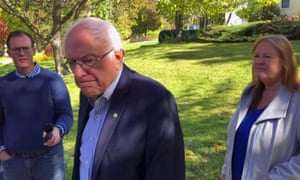 In this image taken from video, Democratic presidential candidate Sen. Bernie Sanders speaks with reporters outside his home, Tuesday, Oct. 8, 2019, in Burlington, Vt.