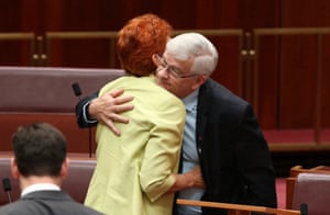 Pauline Hanson congratulates fellow One nation senator Brian Burston after he delivered his first speech in the senate chamber.