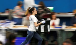 A ballot box is rushed into the counting centre in Sunderland, June 8, 2017.