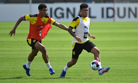 Jadon Sancho, right, and Jude Bellingham compete for possession during a Borussia Dortmund pre-season training session earlier this month