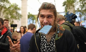 Marco Pierre White Jr holds his new iPhone X outside the Apple Store on Regent Street, London.