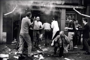 Casualties emerge from the Admiral Duncan pub in Soho, London, following a nail bomb attack by a rightwing extremist on 30 April 1999.