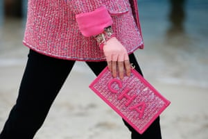 Pink tweed with a logo clutch.