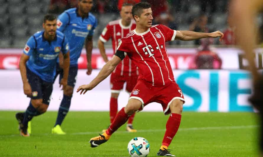 Robert Lewandowski scores Bayern's third goal from the penalty spot after the referee's initial decision was overturned by VAR.