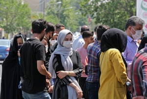 People queue outside a money exchange office in Tehran on Saturday.