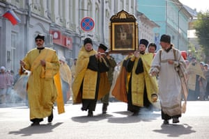 Orthodox clergymen carry an icon of St Nicholas during the Velikoretsky religious procession