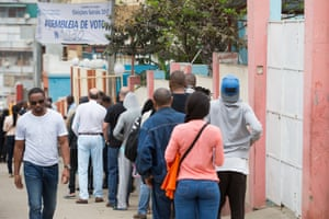 Voters queue to cast their ballots. More than 9.3 million people registered to vote in this year's general election.