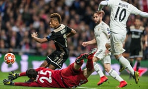 Dani Carvajal watches on helplessly as David Neres scores Ajax's second goal on a humiliating Champions League night for Real Madrid.