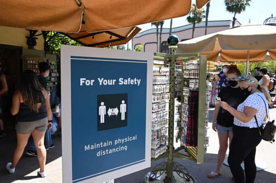 New safety measures remind Downtown Disney visitors to social distance while shopping.