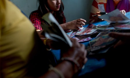 At an office at the Thankot checkpoint in Nepal, staff and police interrogate a young woman thought to be a victim of human trafficking.