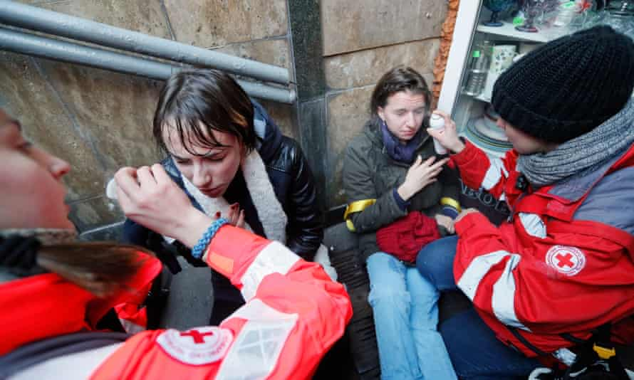 Paramedics rinse eyes of transgender rights activists after a pepper spray attack in downtown Kiev, Ukraine.