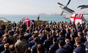 Theresa May addresses sailors on deck of HMS Ocean in Manama.