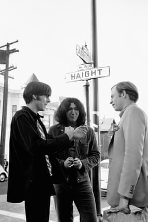 Tom Wolfe pictured with the Grateful Dead's Jerry Garcia (c) and their manager Rock Scully on the corner of Haight and Ashbury in San Francisco