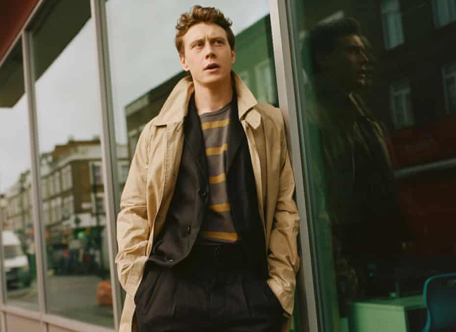 George MacKay, actor, leaning against a shop window, January 2020