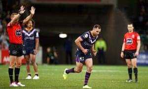Referee Ben Cummins sends Melbourne Storm captain Cameron Smith to the sin bin.