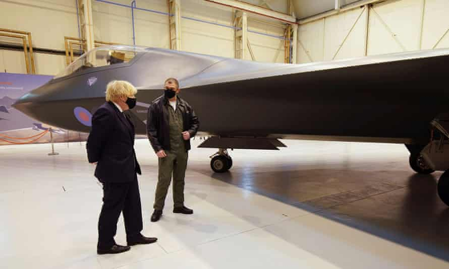 Boris Johnson looks at the Tempest fighter aircraft during a visit to BAE Systems at Warton aerodrome near Preston.