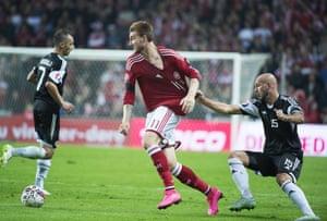 Albania's Arlind Ajeti grabs Nicklas Bendtner's shirt in Copenhagen, still 0-0 there.