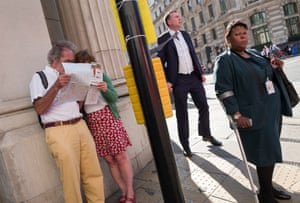 Tourists and workers mingle outside the Bank of England
