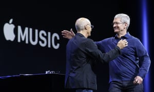 Tim Cook, right, hugs Beats by Dre co-founder and Apple employee Jimmy Iovine as Apple announces its music service.